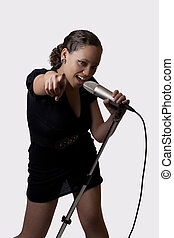 Young mixed ethnic woman with mic pointing