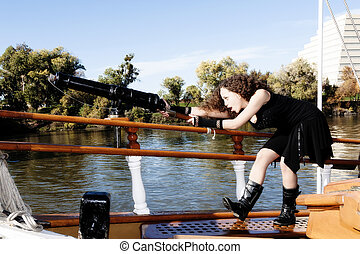 Young Mixed Heritage Woman Aiming Small Cannon
