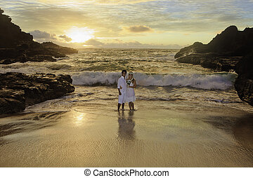 newlywed couple at sunrise - young mixed newlywed couple at...