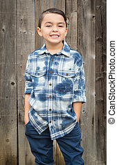 Young Mixed Race Boy Portrait Against Fence