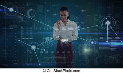 Young mixed race businesswoman using touch technology - ...