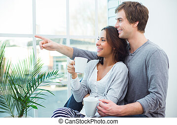 Young mixed race couple at home