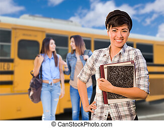 Young Mixed Race Female Students Near School Bus
