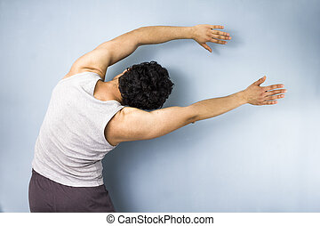 Young mixed race man in yoga side stretch