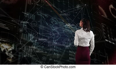 Young mixed race woman using touch technology