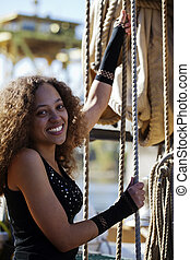 Young Mixed Woman Holding Ropes Smiling Outdoors