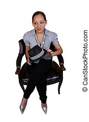 Young Mixed Woman Sitting Holding Hat