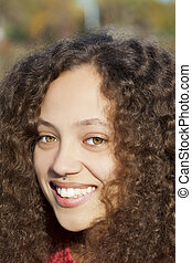 Young Mixed Woman Smiling Outdoors Portrait Piercing