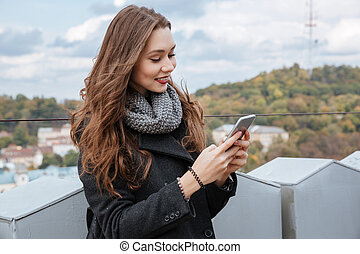 Young model looking at phone