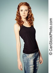 Portrait of a pretty red-haired girl. Copy space.