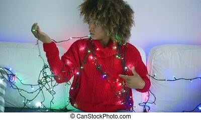 Young model posing with lights - Young beautiful ethnic...