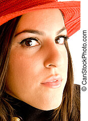 young model posing with red hat