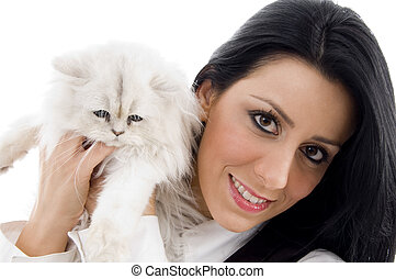 young model standing with white kitten