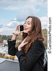 Young model talking at phone