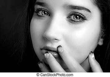 Young model touching her face with her fingers