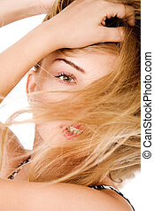 Young model with beautiful hair covered her face
