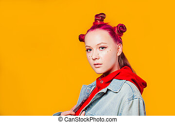 Young model with trendy makeup on yellow background