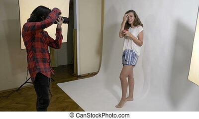 Young model woman dressed casual who sips from a coffee cup...