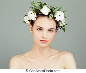 Young Model Woman with Healthy Skin and Flowers. Skincare Concept