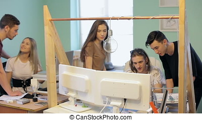 Young modern business people in office