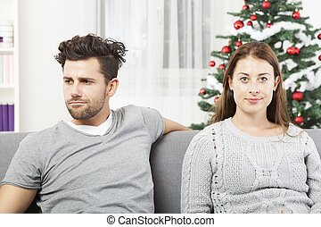 couple is irritated of christmas - young modern couple is...