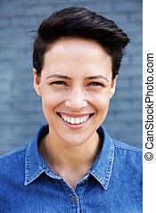 Young modern woman with short hair smiling
