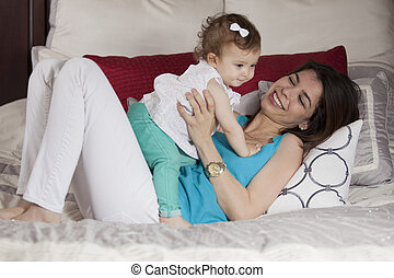 Young mom and baby having fun