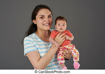 Young mom hold small baby