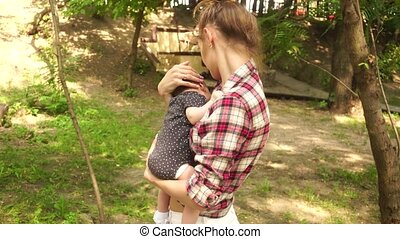 Young mom with baby in her arms