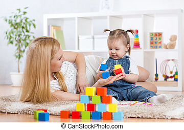Young mom with her child play together