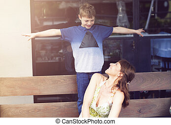 Young mother and her boy smilling outdoor