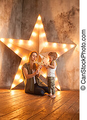 Young Mother and her Child Boy on Studio Background