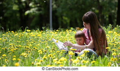 Young mother and her daughter read