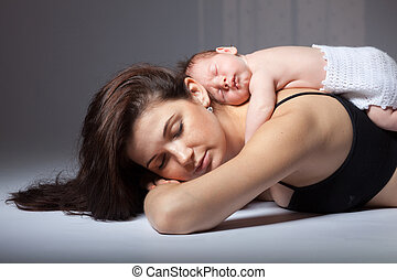 Young mother and her sleeping baby