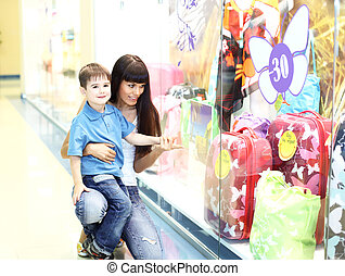 Young mother and son doing shopping