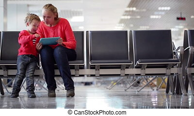 Young mother and son in an airport terminal