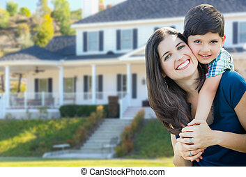 Young Mother and Son In Front Yard of Beautiful Custom House.