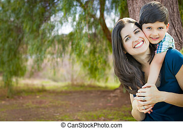 Young Mother and Son Portrait Outdoors.