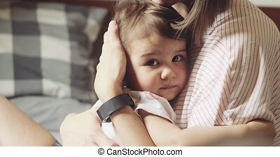 Young mother comforting her upset infant daughter. Cinmeatic...