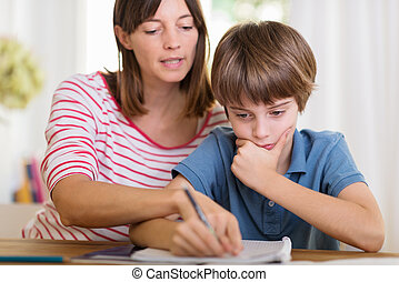 Young mother doing homework with her son