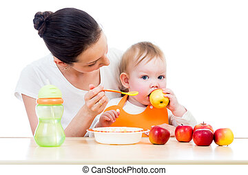 Young mother feeding her baby. Conception of healthy ...