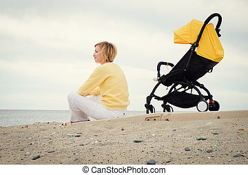 Young mother gets some rest outdoors