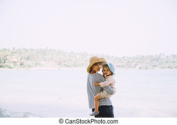Young Mother Holding Cute Little Daughter Tropical Beach