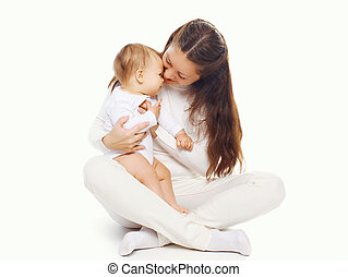 Young mother holding her baby on a white background