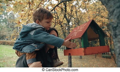 young mother holds on the shoulders a cute little boy, the...
