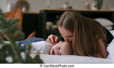 Young mother hugging her newborn child. Mom nursing baby....