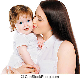 Young mother kiss little baby