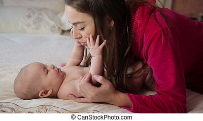 Young Mother Play With Baby