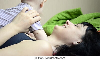 Young mother plays and talks