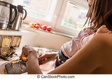 Young mother preparing a meal in the kitchen